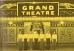 Ushers await outside the Grand Theatre - Around 1930