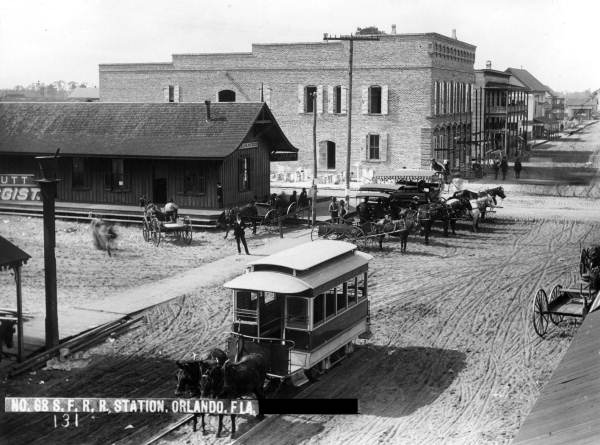 Orlando Street Railway Company - Street Railway down Church Street toward Orange Avenue.  Brick building in the back ground was Bumby Hardware (Now Hamburger Mary's).